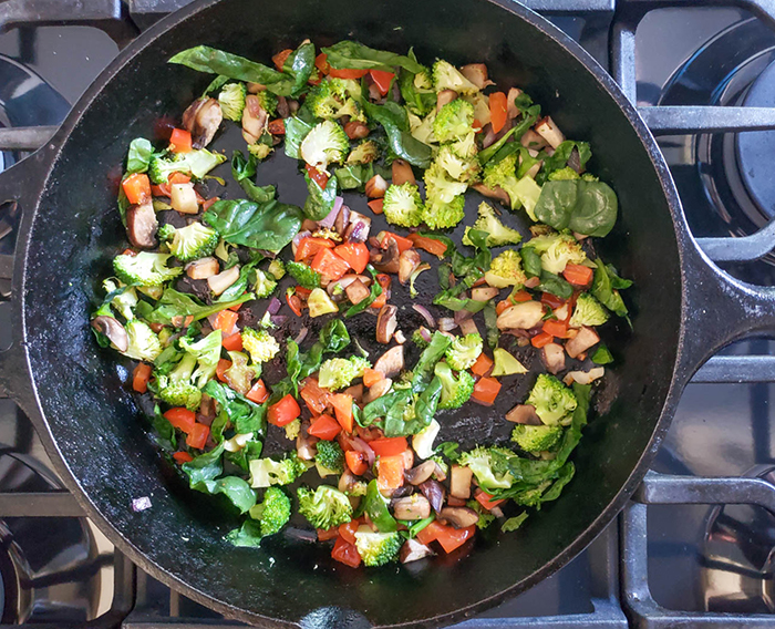 cooked vegetable filling in a skillet