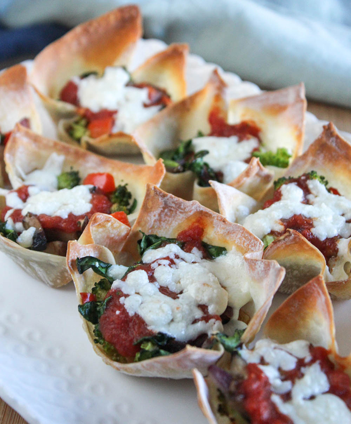 wonton pizza cups on a white plate