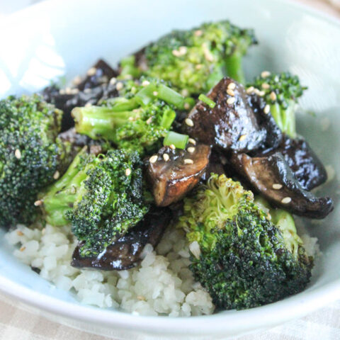 broccoli and mushrooms in a blue bowl with rice
