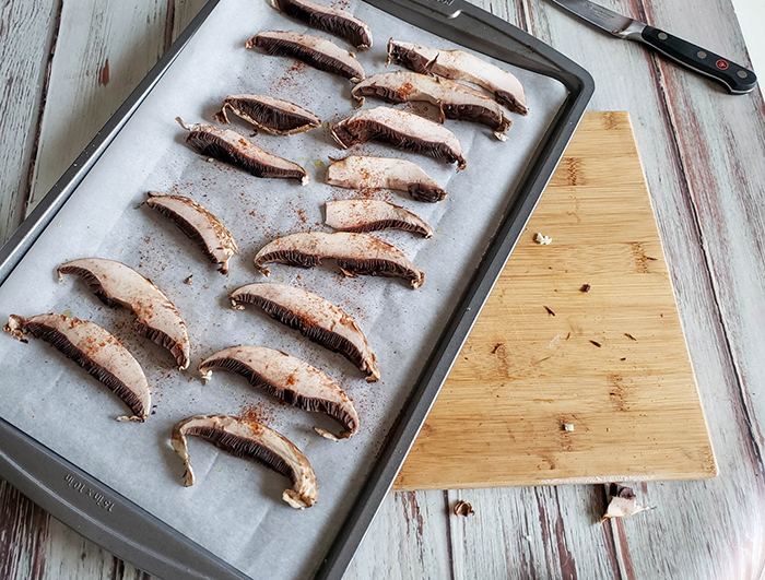 sliced mushrooms on a baking tray