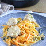 chicken piccata meatballs with butternut squash noodles on a blue plate