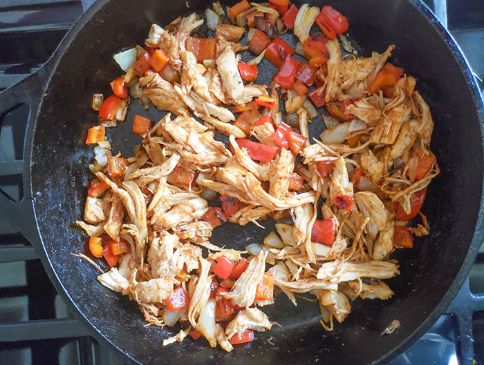 Chicken, peppers, onions in a pan