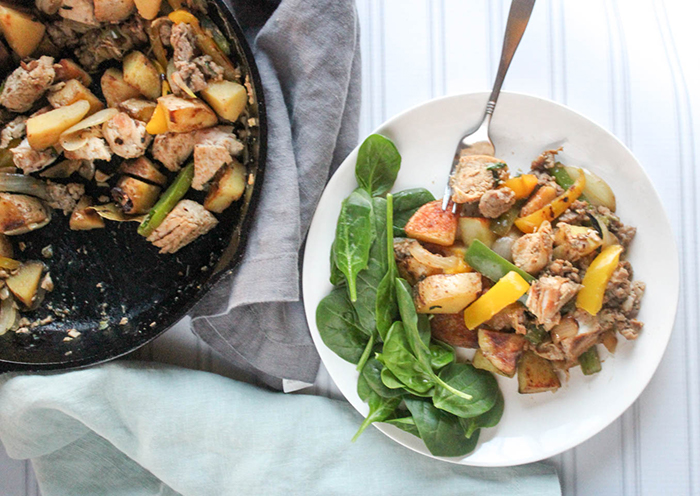 a view of chicken giambotta on a plate with spinach on the side