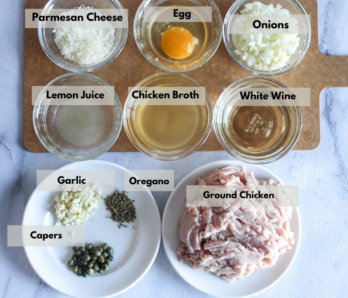 meatball ingredients, parmesan cheese, egg, onions, lemon juice, chicken broth, wine, garlic, oregano capers, chicken