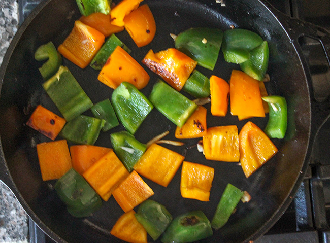 peppers cooking in a skillet