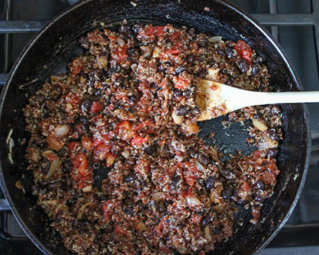 all of the taco filling mixed together in a pan.