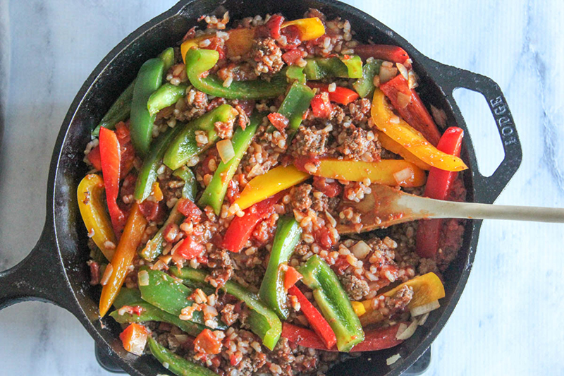 overhead view of unstuffed peppers in a pan