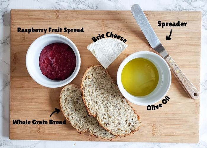 Grilled cheese ingredients: bread, raspberry spread, cheese and oil