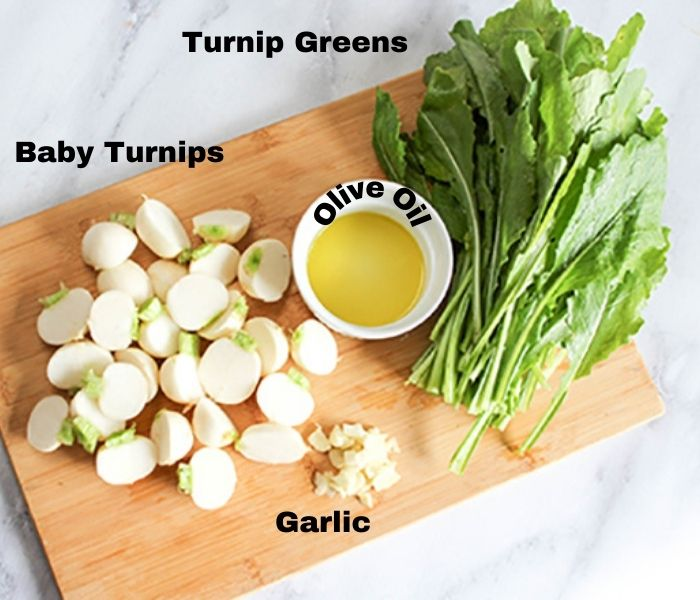 The ingredients: chopped garlic, baby turnips, olive oil and turnip greens