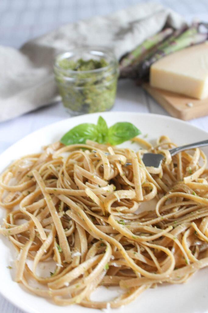asparagus pesto on a plate with a fork