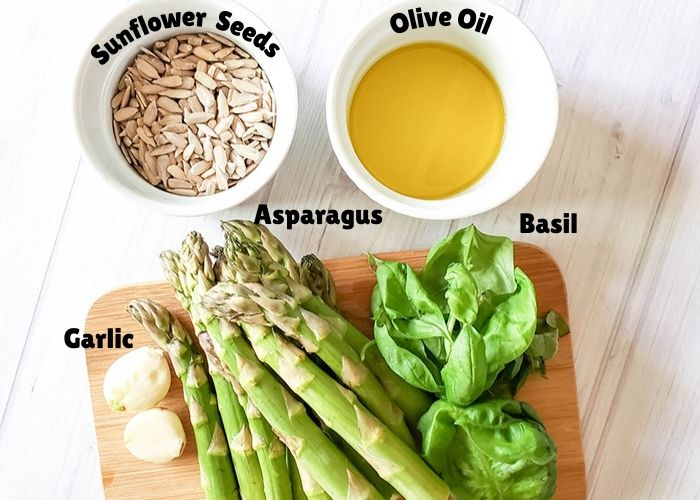 The ingredients for the pesto: sunflower seeds, olive oil, garlic asparagus basil