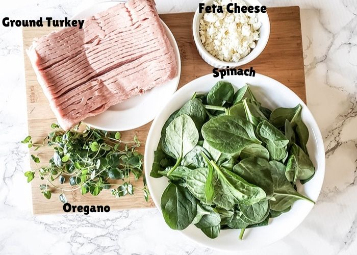 overhead view of ingredietns: ground turkey, oregano, spinach and feta cheese