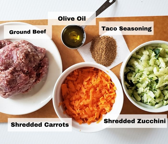 A picture of ingredients for healthy taco meat: ground beef, shredded carrots and squash, taco seasoning and olive oil