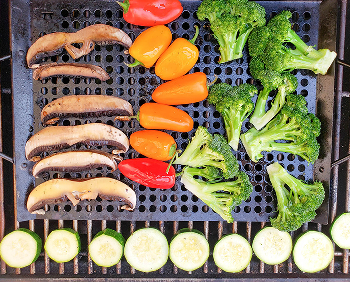 a picture of vegetables cooking on a grill