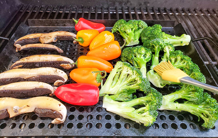 Vegetables on the grill with basting brush