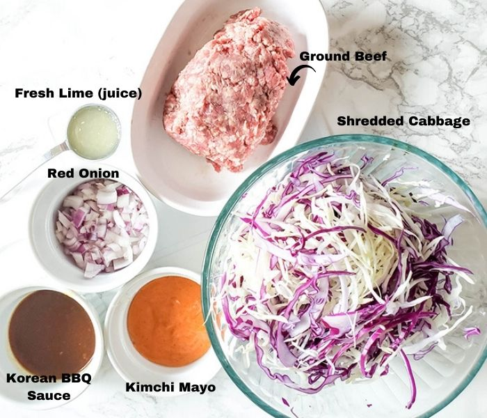 The taco ingredients: Korean BBQ sace, Kimchi Mayo, Shredded Cabbage, Onion, lime juice, ground beef