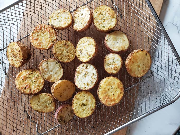 air fryer potatoes cooked on air fryer tray