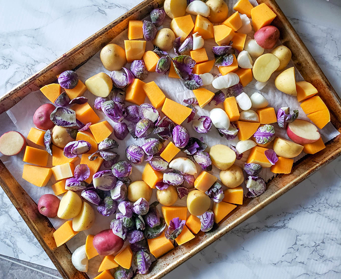an overhead view of the vegetables on a sheet pan