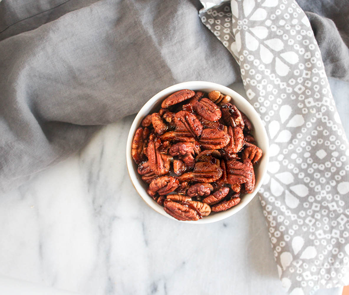 an overhead view of sweet and spicy pecans in a bowl