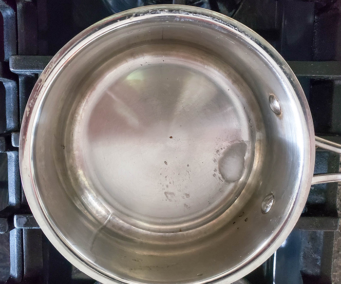 coconut oil melting in a saucepan