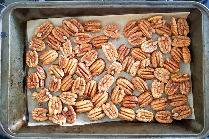 Pecan halves on a baking pan