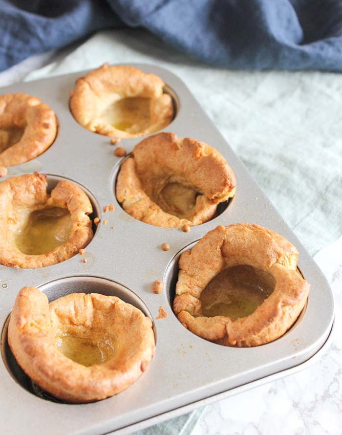a muffin tray of baked yorkshire puddings