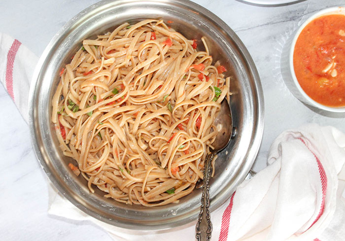 bowl of pasta with blush sauce on it.