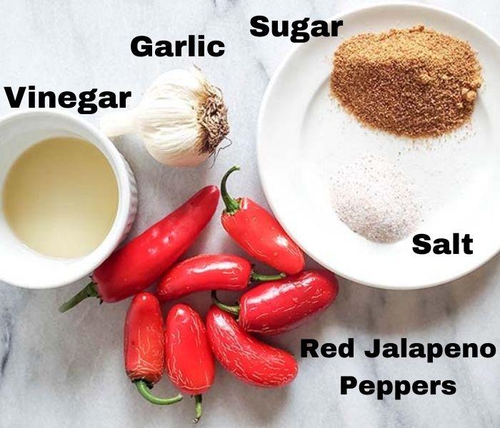 The ingredients for sriracha sauce: jalapeno peppers, vinegar, garlic, salt and sugar